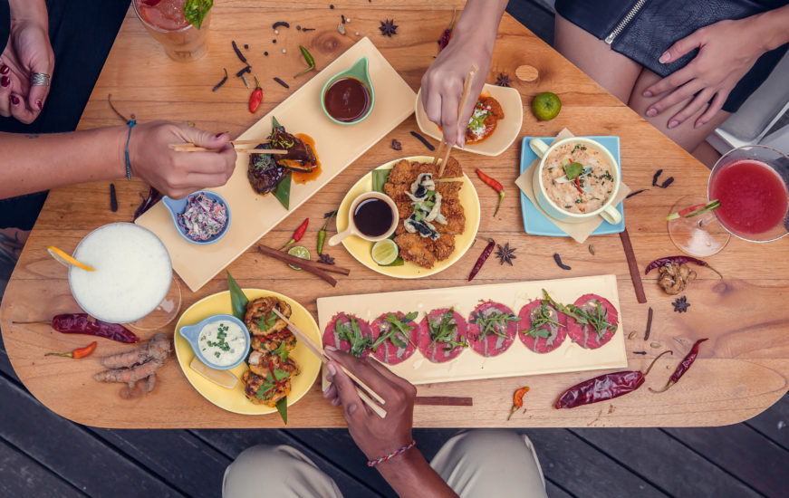 People taking food from table. Top view