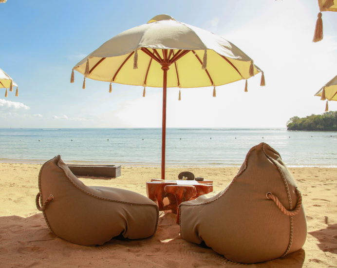 Many bean bags outdoor on the sand beach for relaxing with ocean view